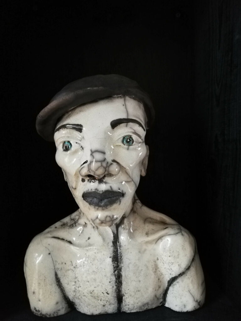 Raku personnage homme avec casquette